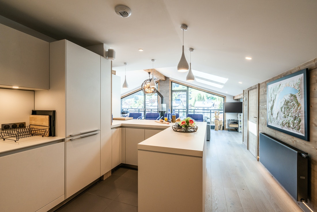 Fully-equipped white kitchen at Ozigo accommodation in Les Gets