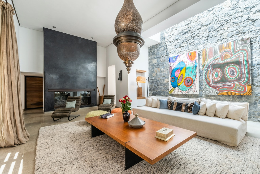 Modern living room with stone wall at Marhba luxury private villa in Marrakech
