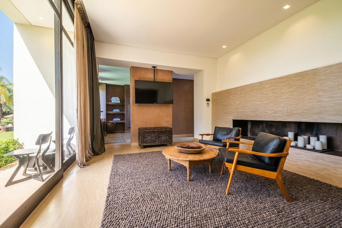 Contemporary lounge area with copper lamp shade at Zagora private villa in Marrakech