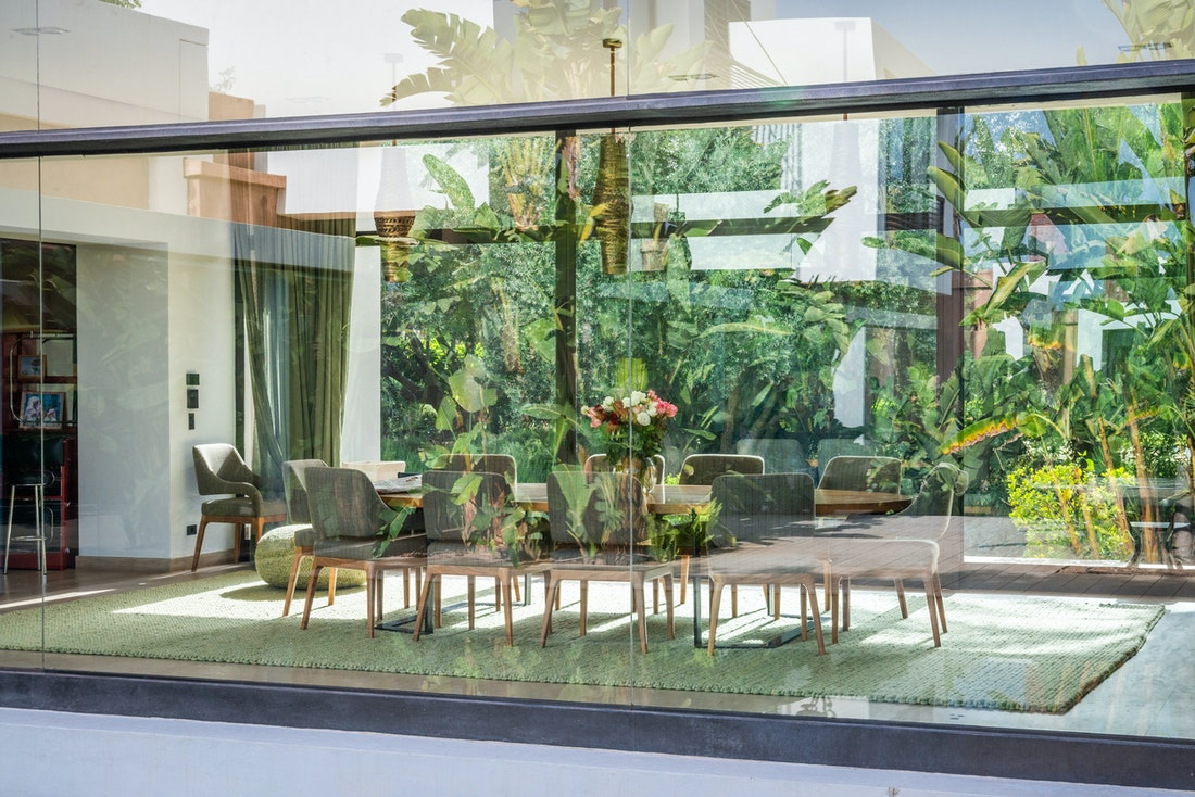 Contemporary living room with jungle garden view at Zagora private villa in Marrakech