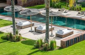 Private pool and raffia sun beds at Zagora private villa in Marrakech