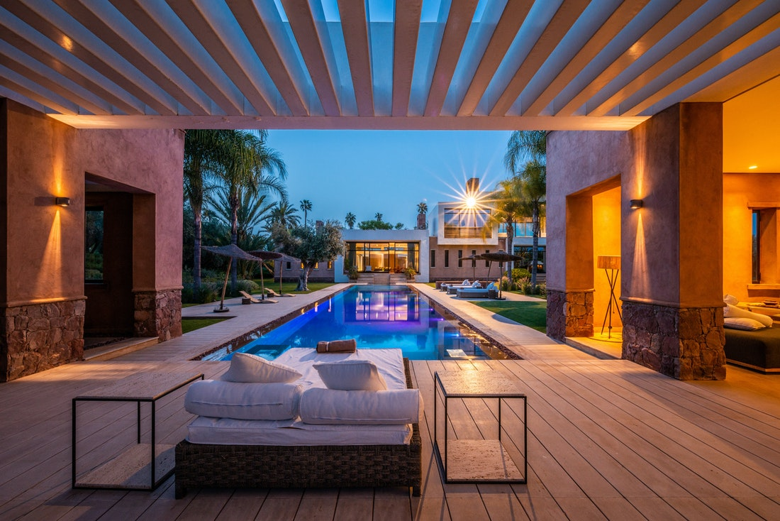 Views of the swimming pool at night from the outdoor lounge of Zagora private villa in Marrakech