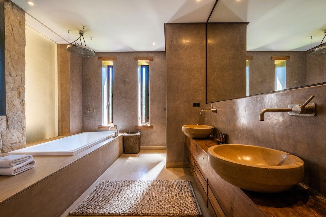 Contemporary concrete bathroom with rain shower at Zagora private villa in Marrakech