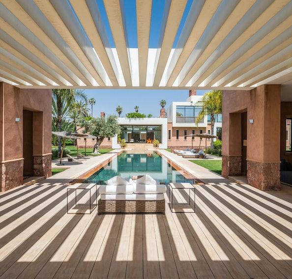 Design patio area with swimming pool view at Zagora private villa in Marrakech
