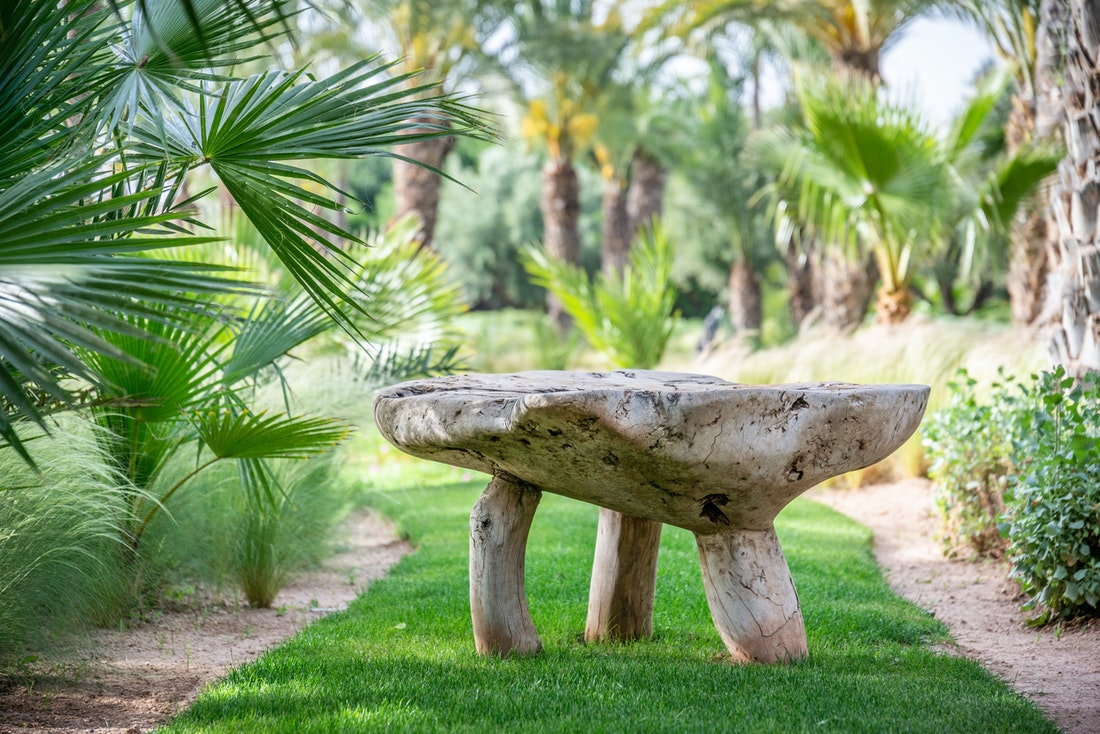 Wooden bench in the private garden of Marhba luxury private villa in Marrakech