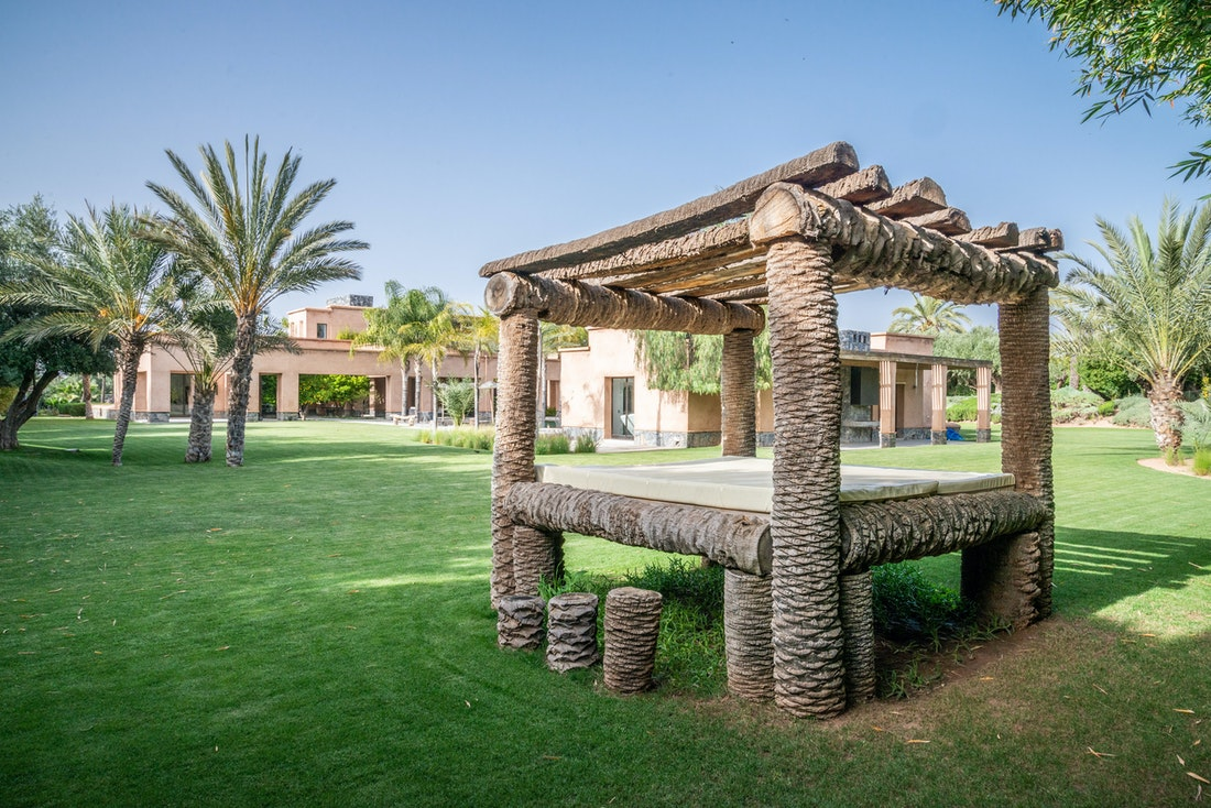 Private garden with outdoor daybed pergola at Marhba luxury private villa in Marrakech