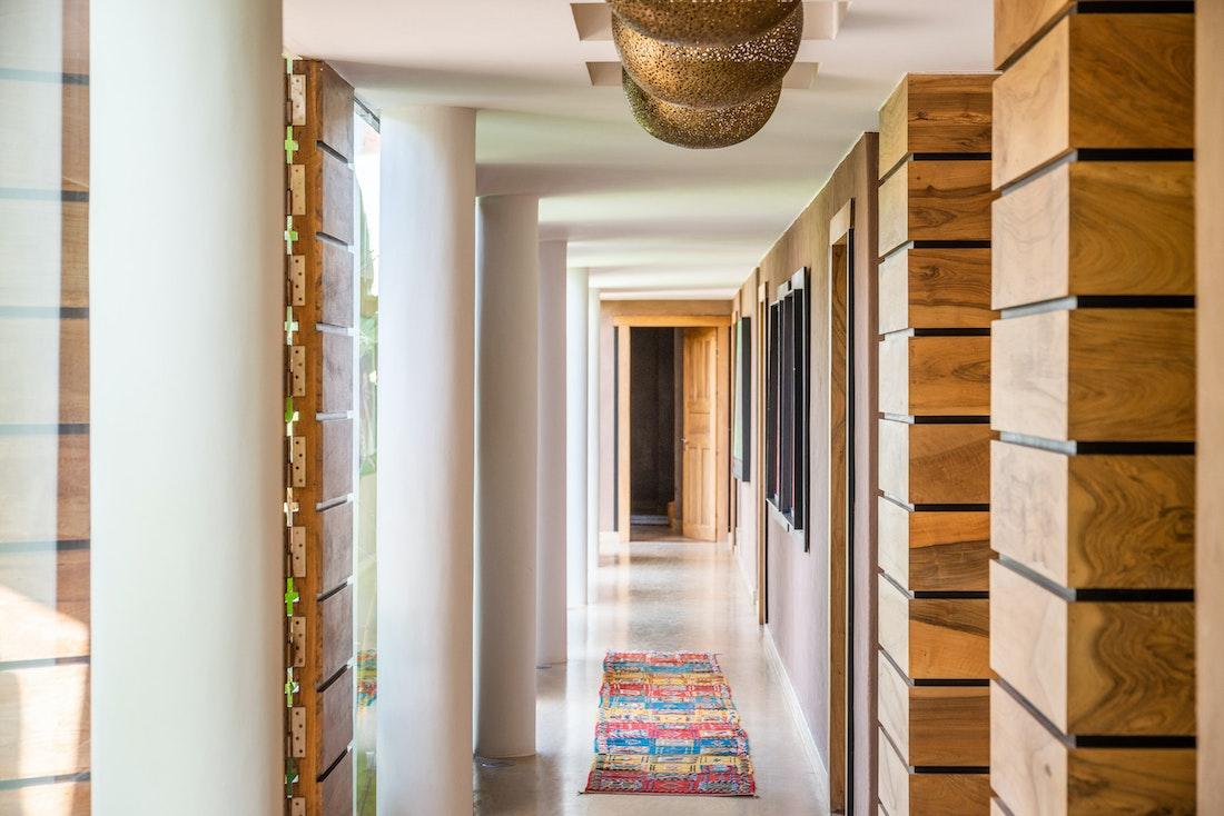 Real wood walls and Moroccan rugs at Zagora private villa in Marrakech