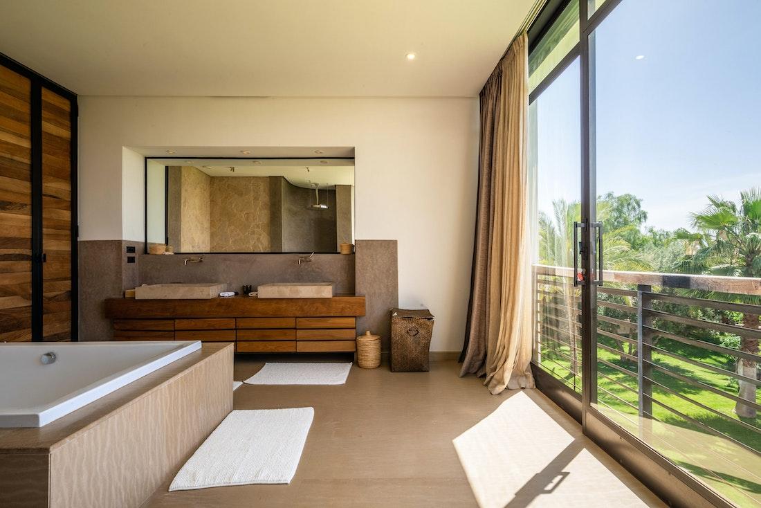 Ethnic and minimalist bathroom at Zagora private villa in Marrakech
