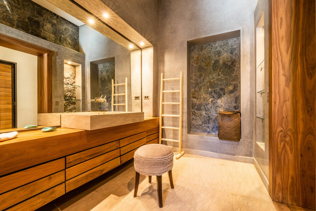 Ethnic bathroom with concrete sink and wooden bathroom furniture at Marhba luxury private villa in Marrakech