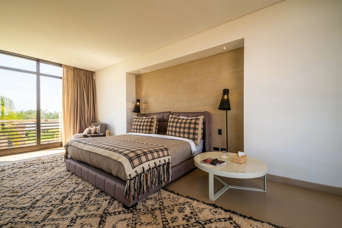 Ethnic bedroom with large berber rug at Zagora private villa in Marrakech