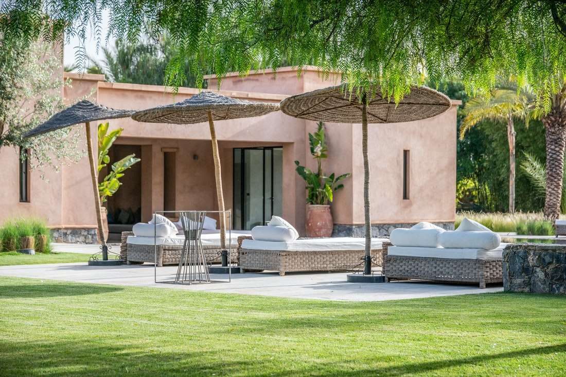 Raffia sun-beds at Marhba luxury private villa in Marrakech