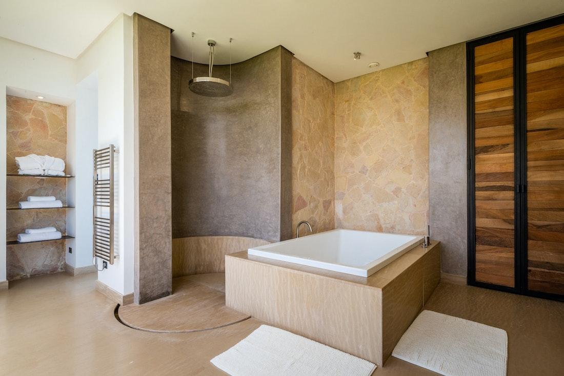 Industrial bathroom with rain shower at Zagora private villa in Marrakech