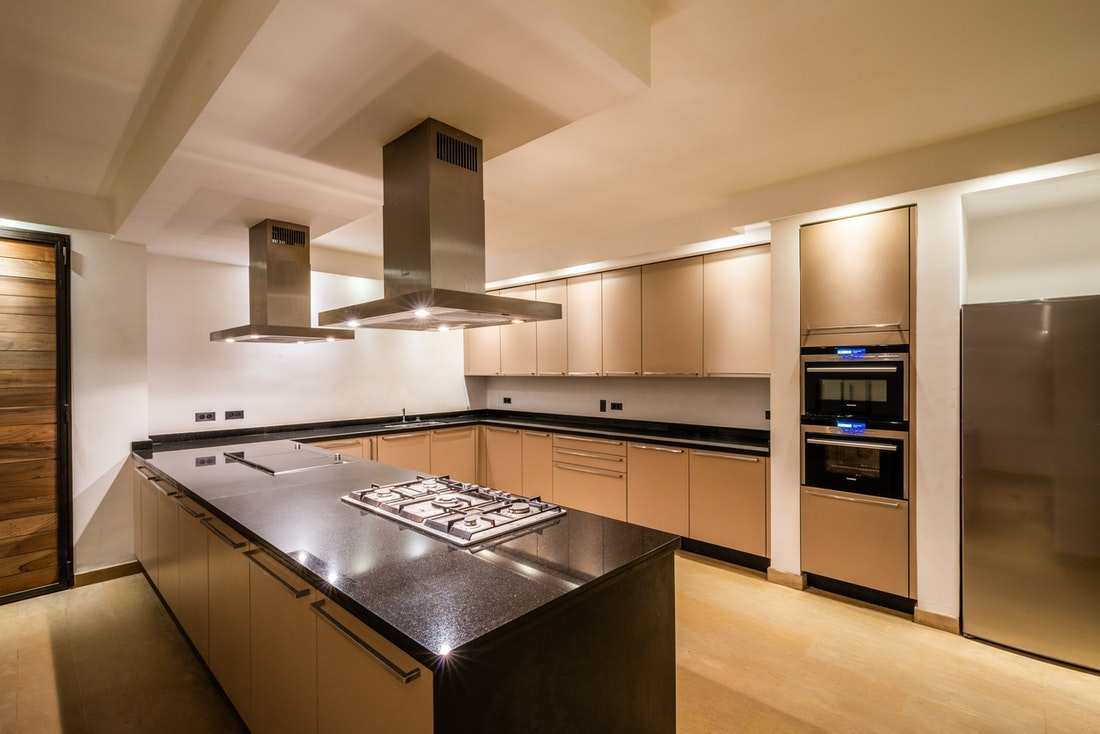 Contemporary beige and black open-kitchen