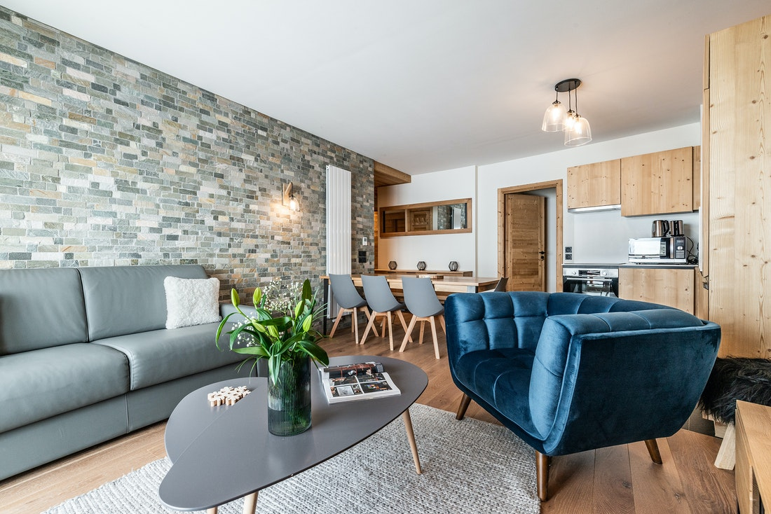 Family living room dining area luxury ski in ski out apartment Sorbus Alpe d'Huez