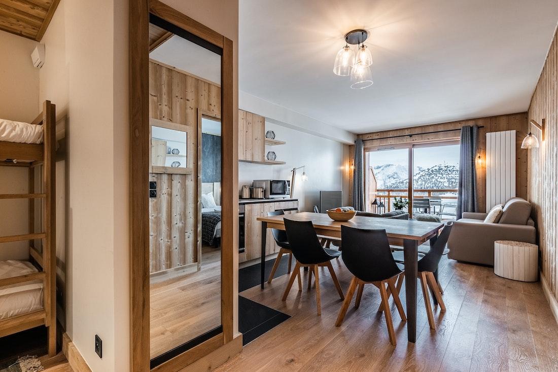 Modern dining room luxury ski in ski out apartment Thuja Alpe d'Huez