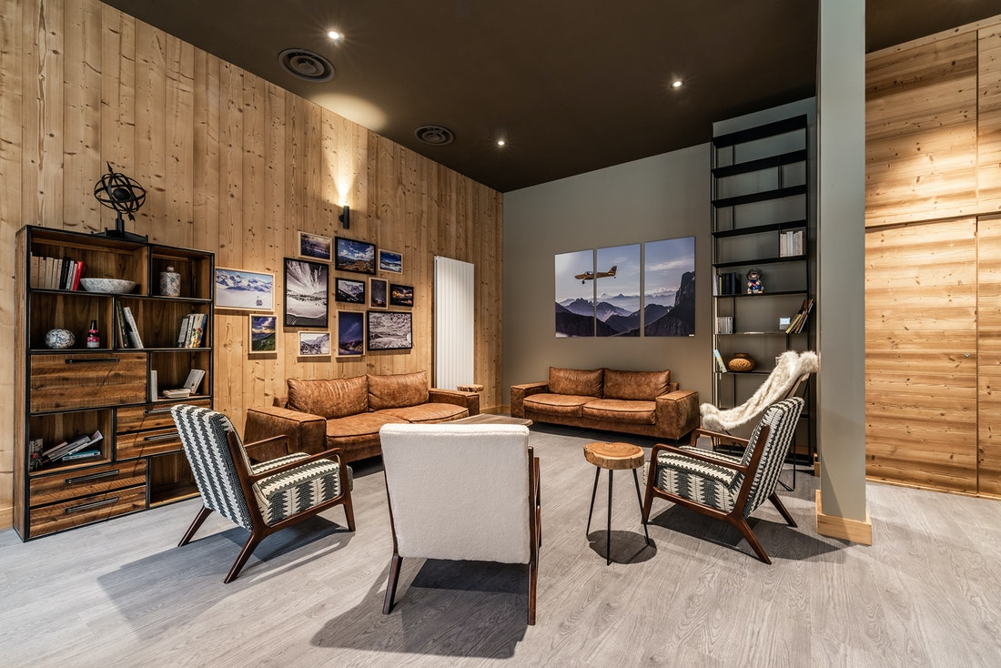 Communal lounge leather chairs luxurious residence apartment Juglans Alpe d'Huez
