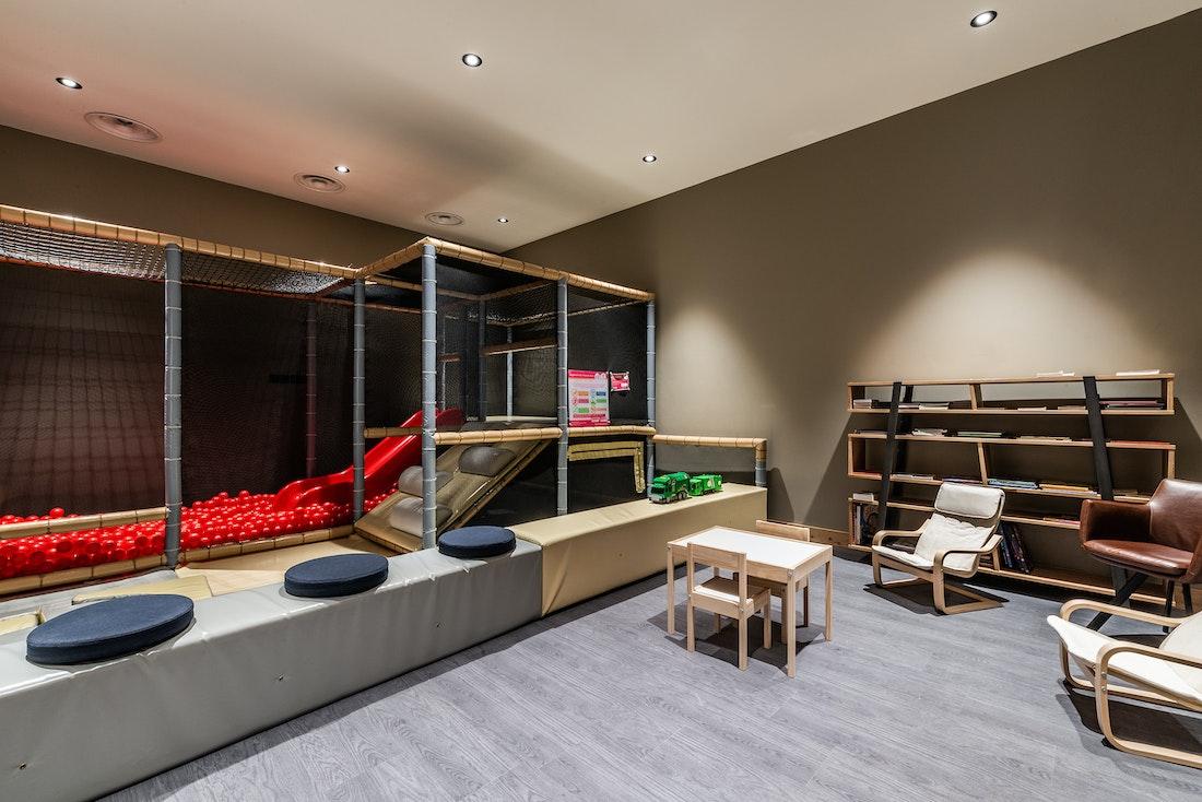 Communal lounge kids playing area luxurious residence apartment Juglans Alpe d'Huez