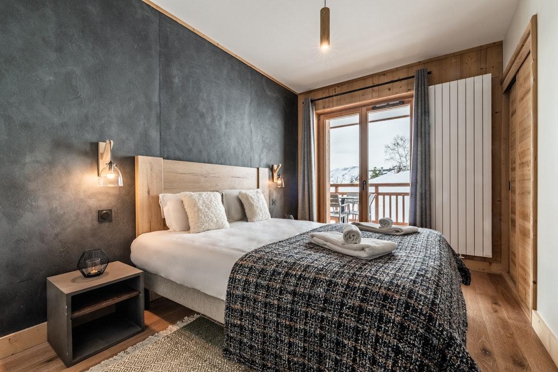 Spacious double bedroom alpine views ski in ski out apartment Sorbus Alpe d'Huez