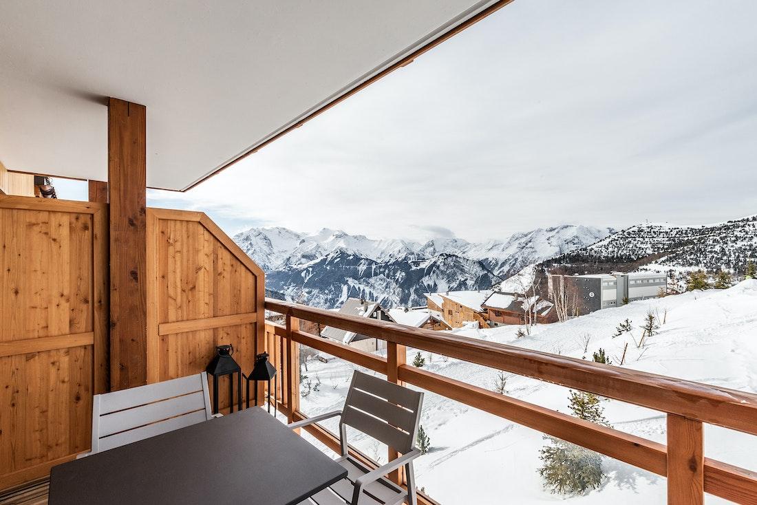 Spacious terrace view mountains luxury ski in ski out apartment Thuja Alpe d'Huez