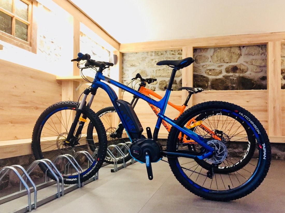 Orange and blue bikes in a bike storage room