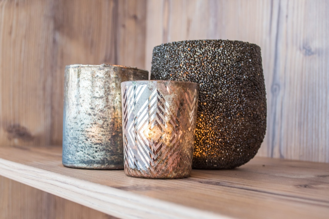 Three candles with metallic pots