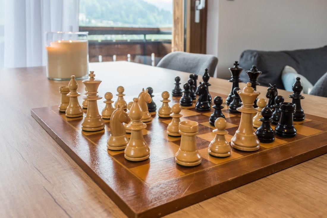 Black light brown chess game Takian apartment Morzine