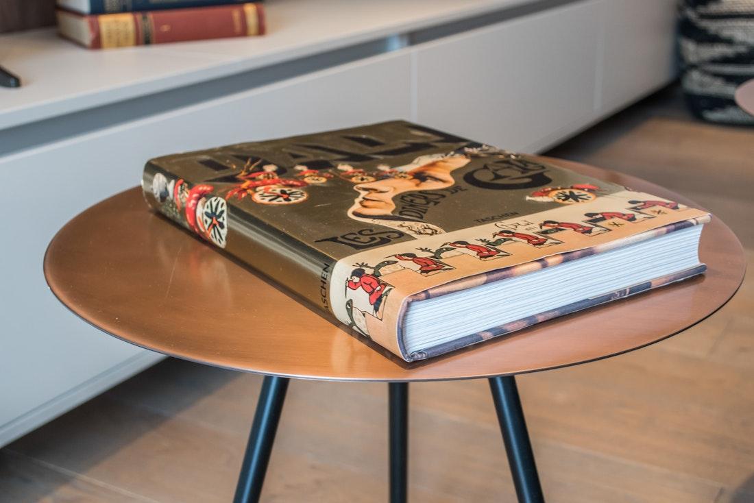 Gold art book on a metallic table