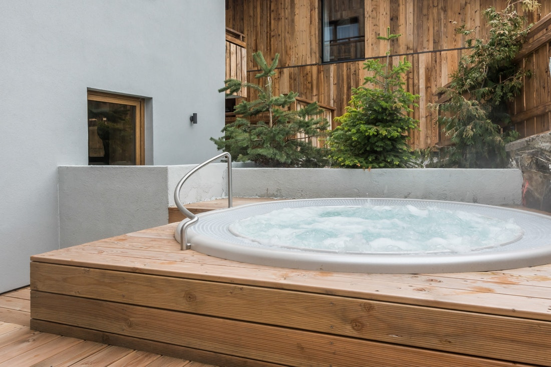 Outside hot tub of Le Rouge luxury chalet in Morzine