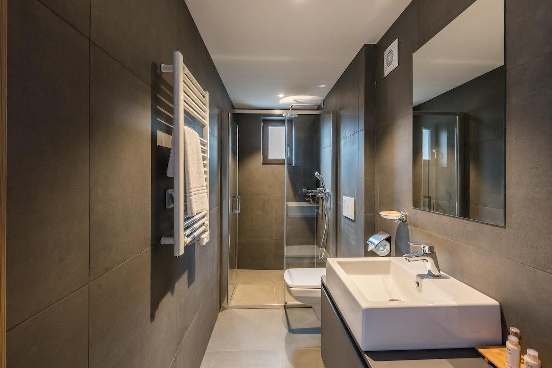 Modern bathroom walk-in shower ski apartment Ayan Morzine