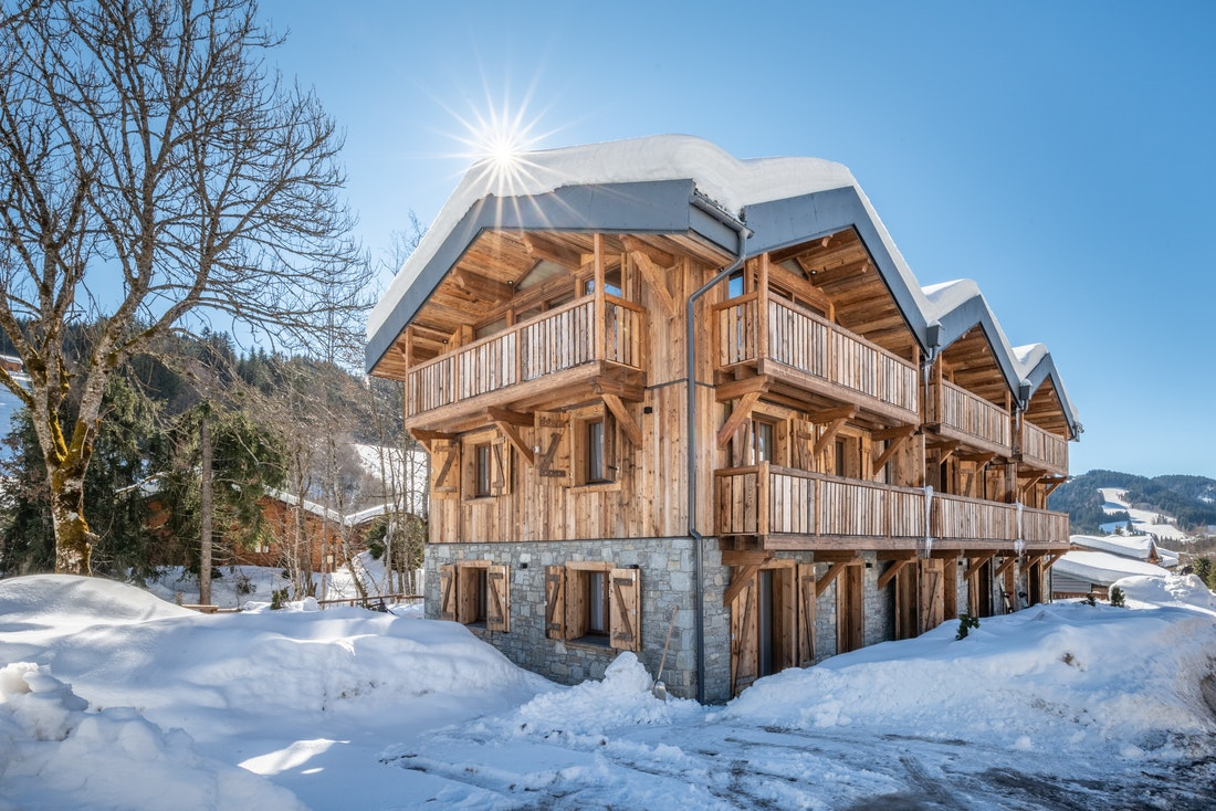 Outside view of Moulin III luxury chalet in Les Gets with snow