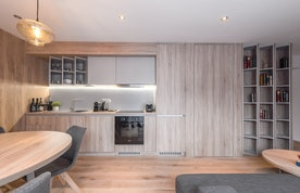 Wooden full-equipped kitchen of Meranti accommodation in Morzine
