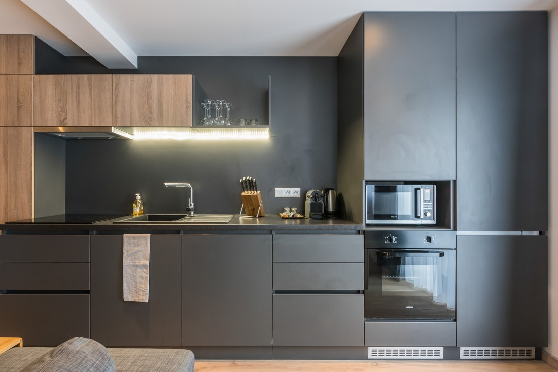 Dark grey and wooden kitchen at Lovoa accommodation in Morzine