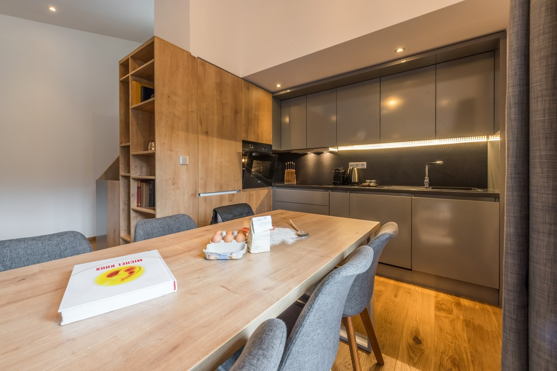 Wooden dining table of a kitchen at Agba accommodation in Morzine