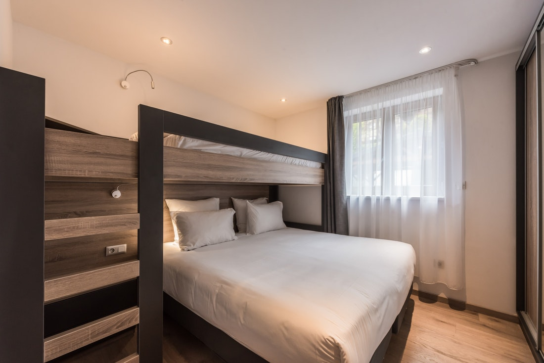 Double bed and bunk bed at Lovoa accommodation in Morzine