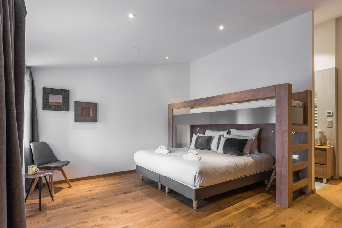 Modern double bedroom mezzanine ample cupboard space landscape views family apartment Agba Morzine