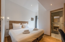 Double bed with fresh linen at Agba accommodation in Morzine