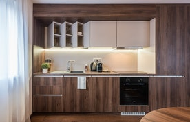 Wooden fully-equipped kitchen at Catalpa accommodation in Morzine