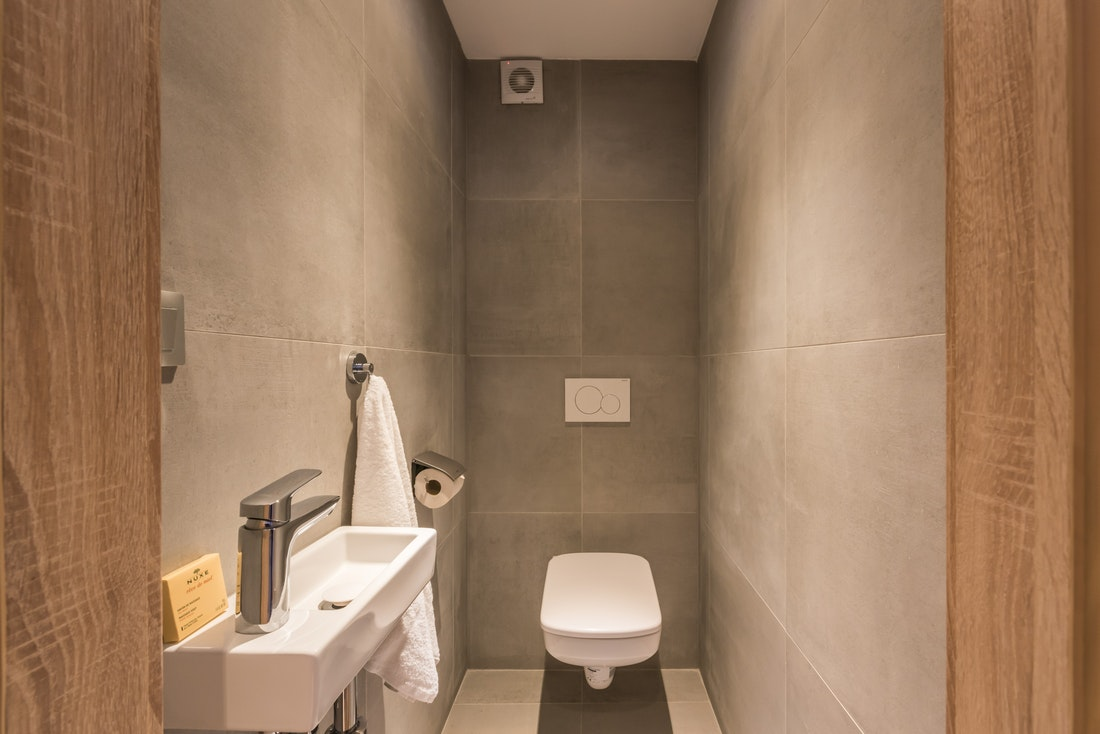 Modern grey toiletroom at Lovoa accommodation in Morzine