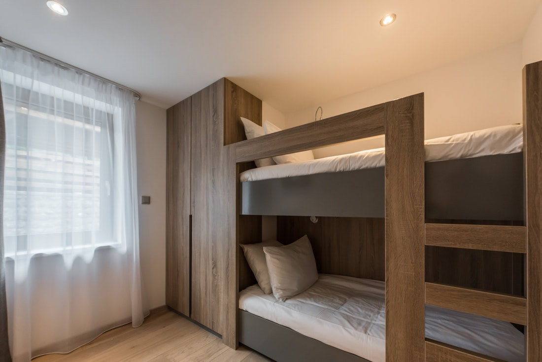 Wooden bunk beds for kids at Ipe accommodation in Morzine