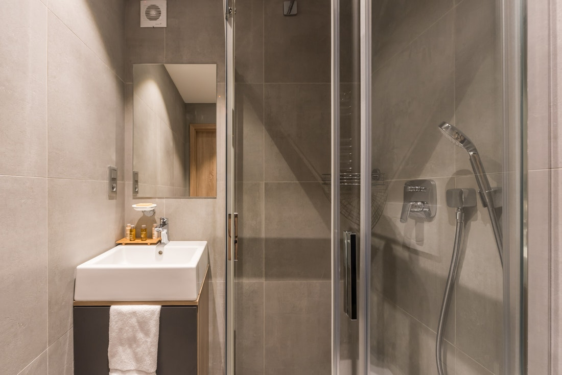 Modern grey bathroom at Lovoa accommodation in Morzine