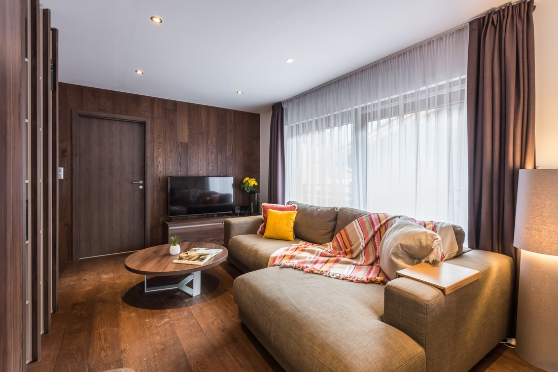 Wooden living room with tv at Catalpa accommodation in Morzine