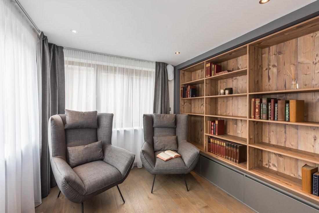 Grey armchairs spacious living room luxury ski apartment Ayan Morzine