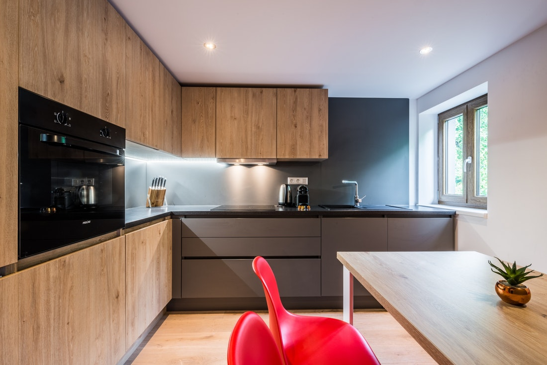 Black and wood modern fully-equipped kitchen at Karri accommodation in Morzine