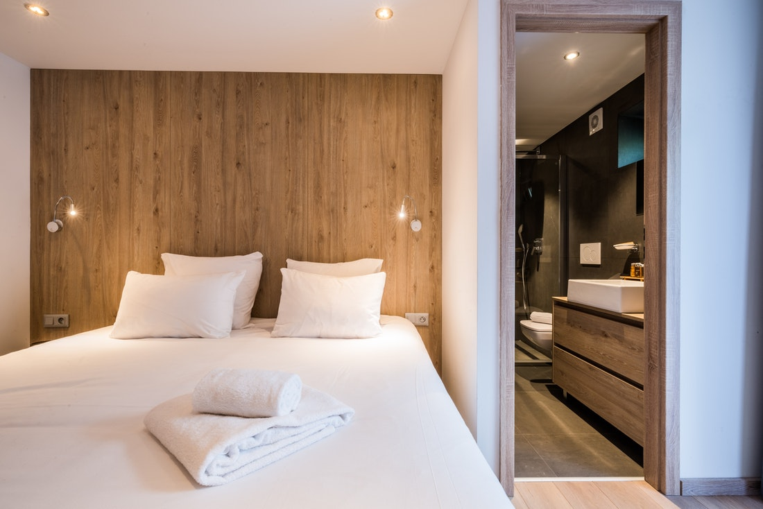 Double bedroom with fresh towels at Karri accommodation in Morzine