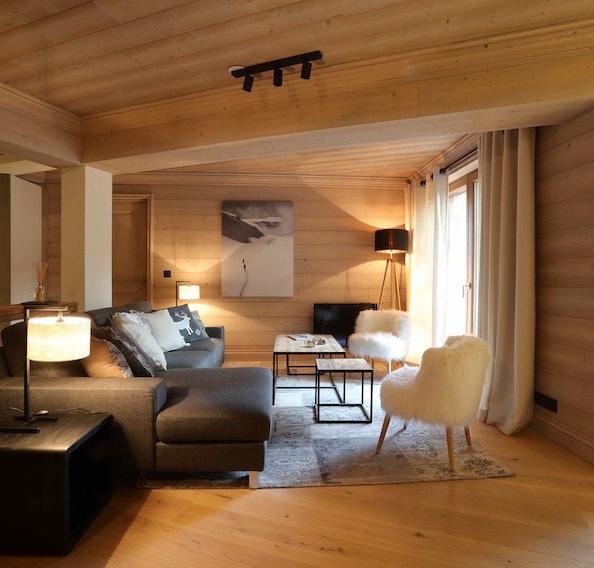 Spacious alpine living room luxury family apartment Padouk Courchevel Moriond