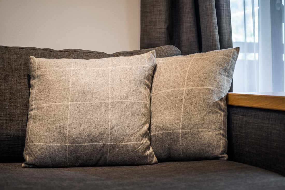 Light grey and white grid pillows