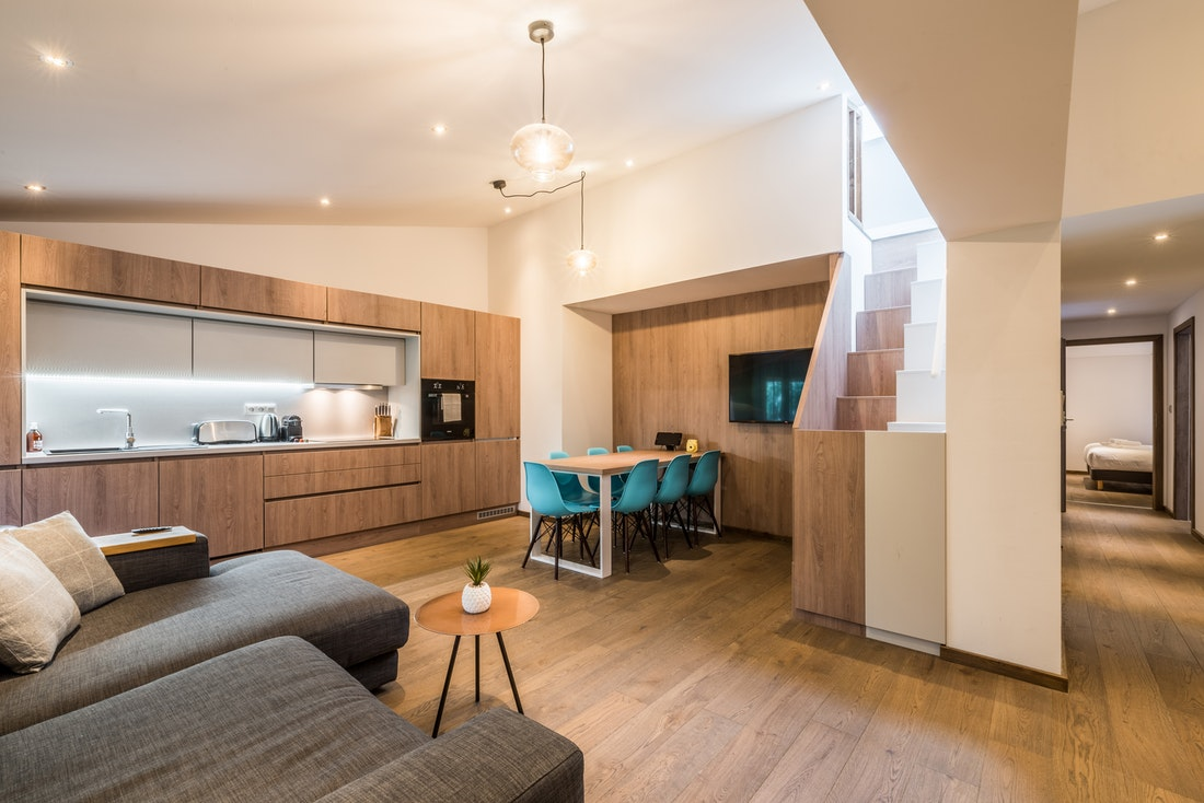 Open fully-equipped kitchen and large living room at Kauri accommodation in Morzine