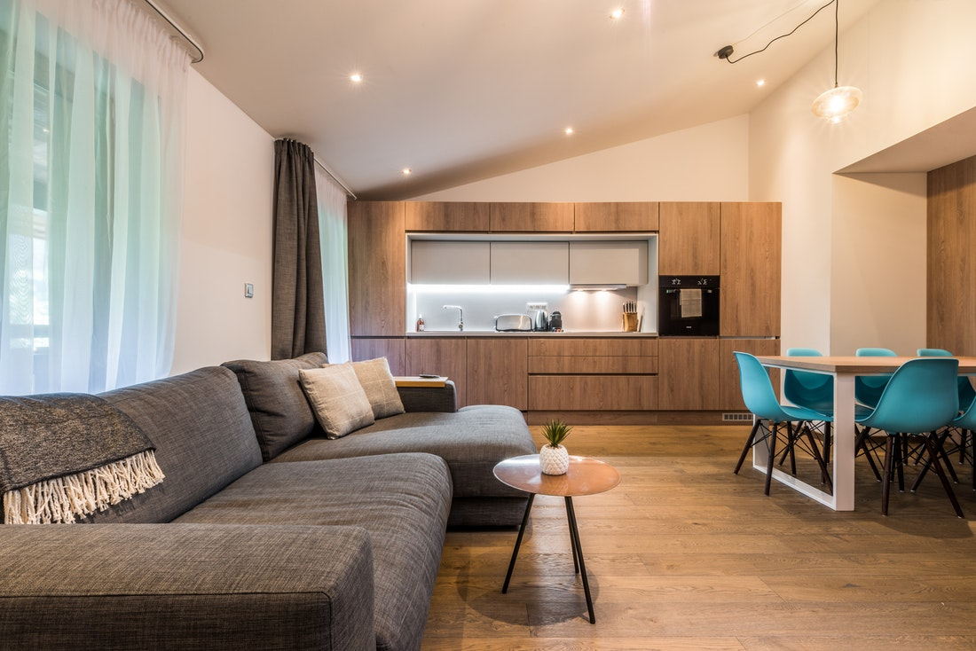 Living room and fully-equipped kitchen at Kauri accommodation in Morzine