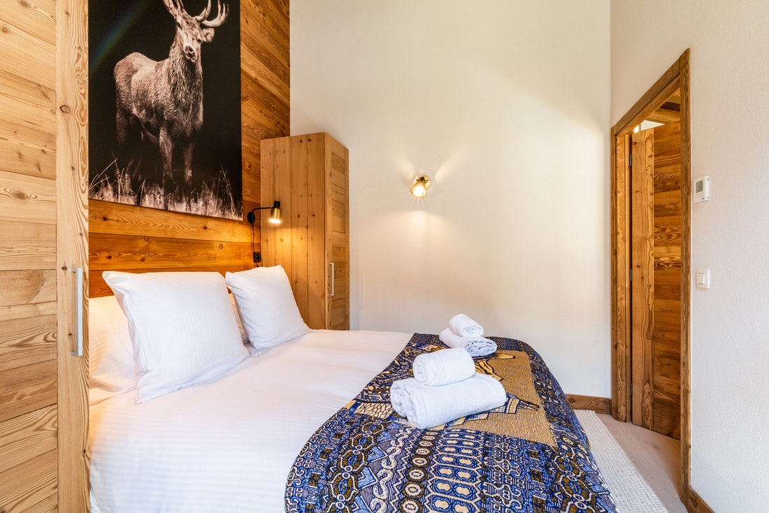 Double bedroom with art work at Sapelli accommodation in Chamonix