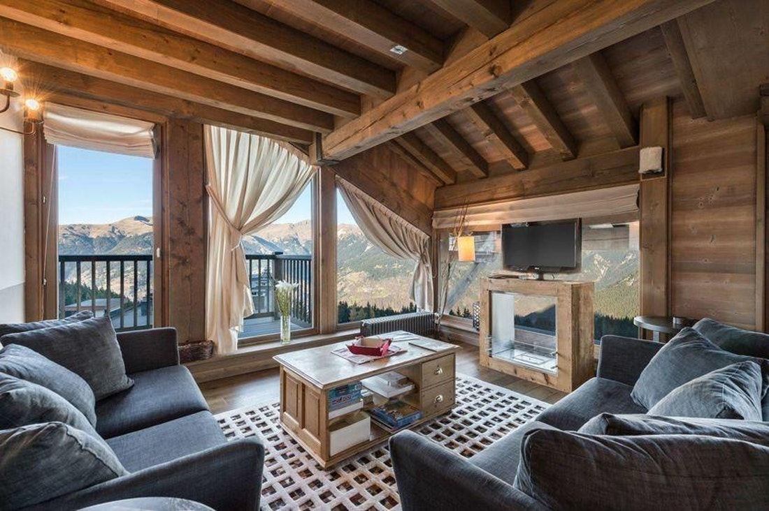Spacious alpine living room luxury family apartment Tiama Courchevel 1850